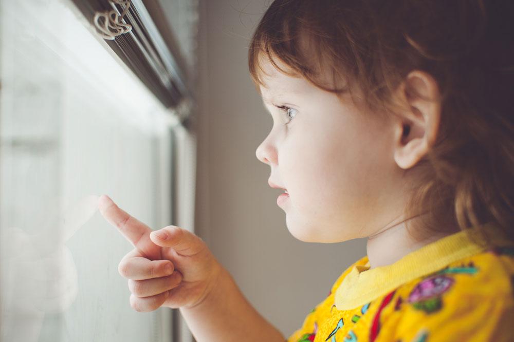 Little Kid Looking Out of Window