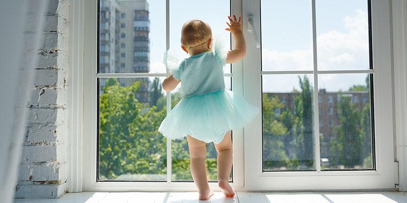 baby fairy next to wide window