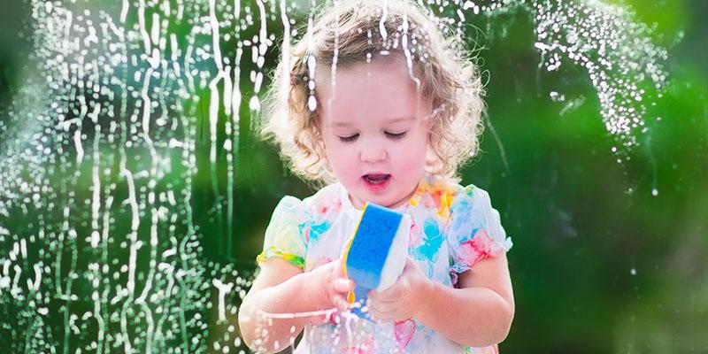 little girl window cleaning