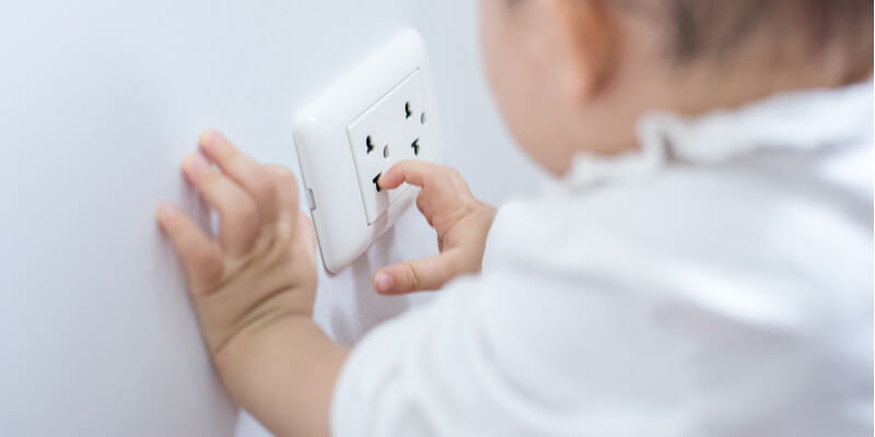 baby playing with power socket